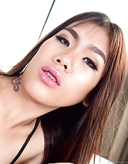 Ultra-slim Thai ladyboy Pat is an adorably exotic young creature with pert, tiny tits and braces on her teeth. This horny T-girl shows us her favorite masturbation techniques. She pulls her black lace panties to one side and reveals her slender, curved, u